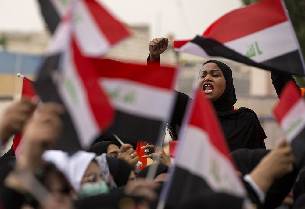 An Iraqi demonstrator takes part in an anti-government march in the centre of the southern city of Basra on 2 December 2019.
