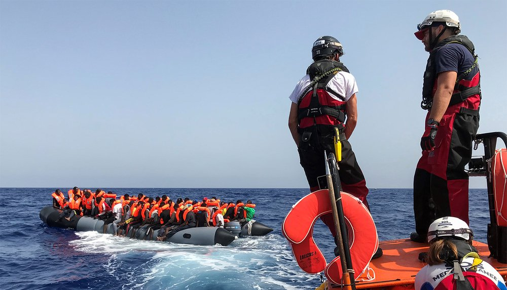 Photo of migrants in a boat in the Mediterranean.
