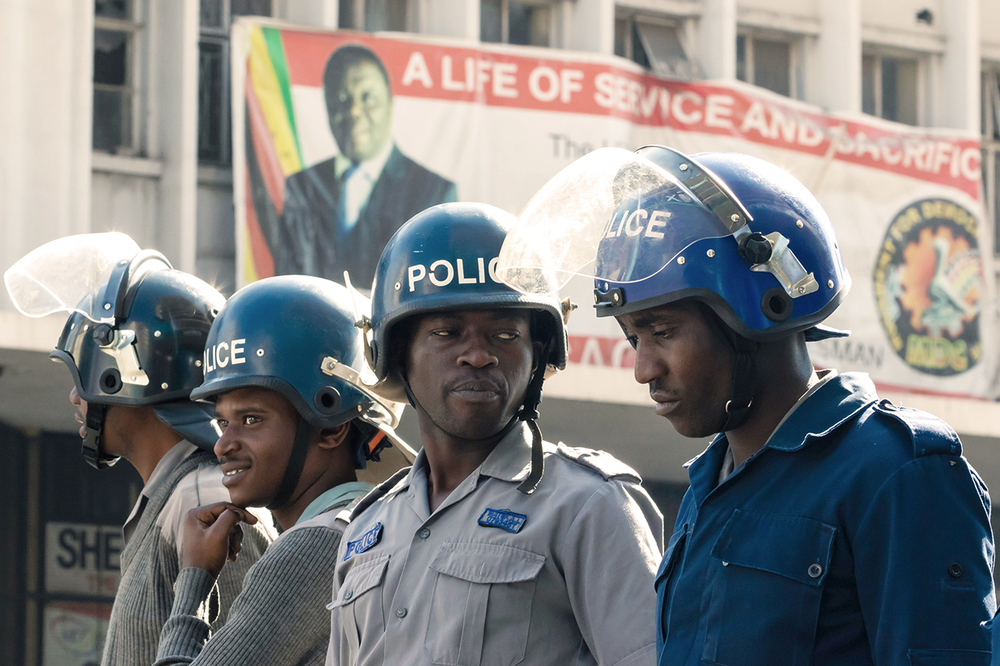 Photo of police in riot gear in Zimbabwe at protest.