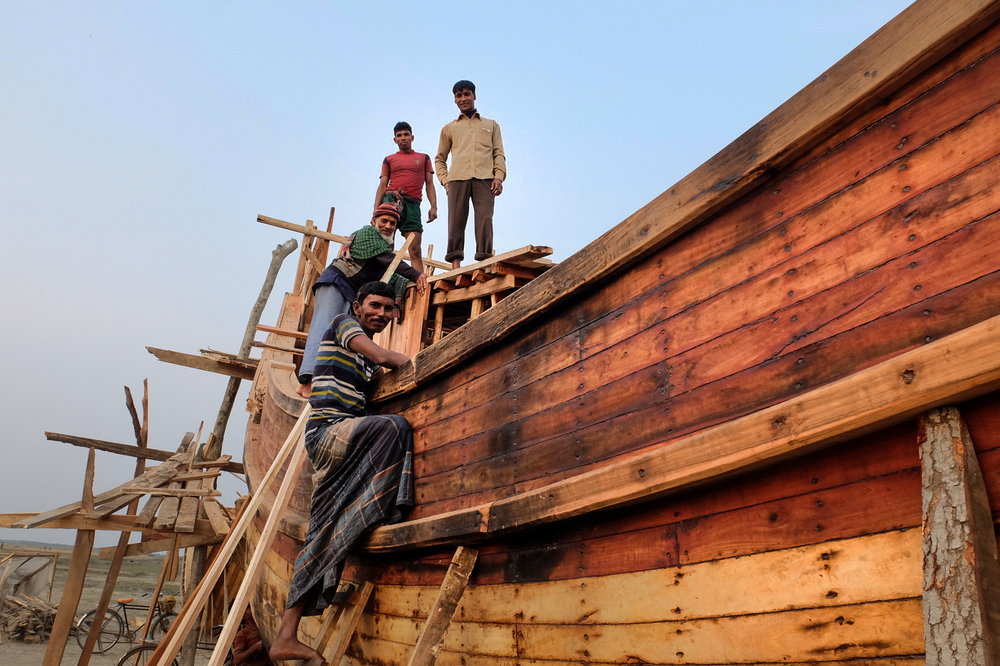 Workers construct a boat in Kazir Bazar, a fishing settlement on the east coast of Hatiya island