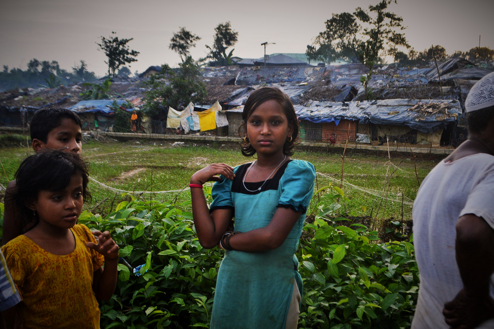 Rohingya refugee children from Myanmar stand outside Kutupalong camp in Bangladesh.