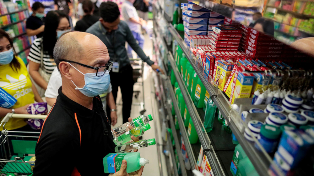 People hoard supplies after the Philippine government confirmed the first case of the new coronavirus in the country on 30 January.