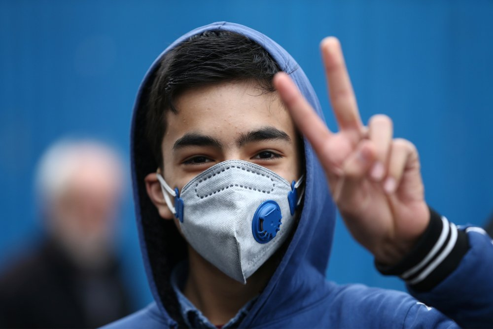 An Iranian boy wears a protective mask to ward off coronavirus in Tehran, Iran February 20, 2020.