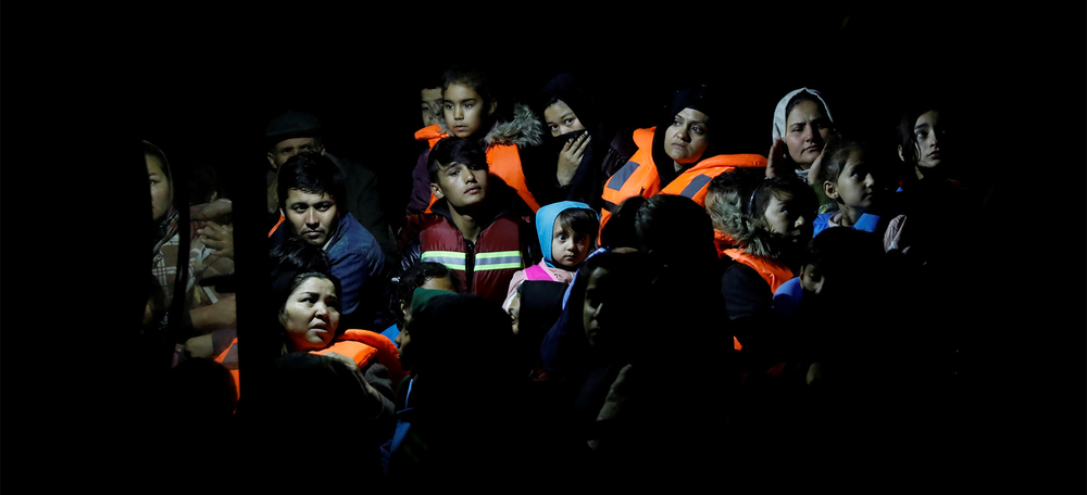 Migrants from Afghanistan, rescued at open sea, are seen on board a Frontex patrol vessel, at the port of Skala Sikamias, on the island of Lesvos, Greece, 17 October 2019.
