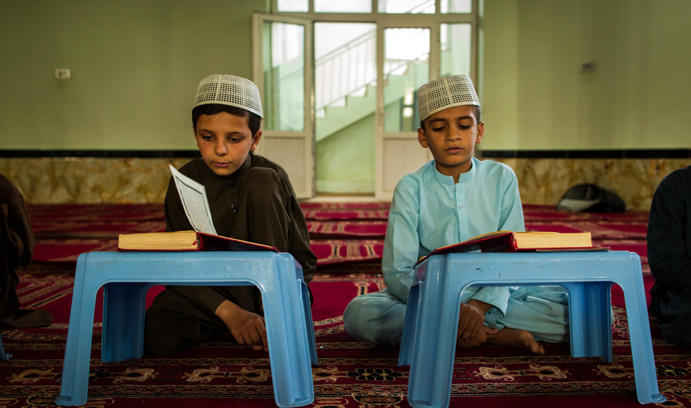 Two children reading at a mosque in Kabul