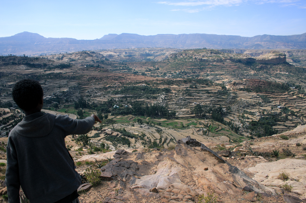 A boy looks over from a clifftop in the Tigray region of northern Ethiopia