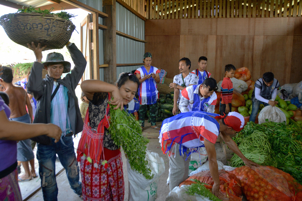 A donation of vegetables from a community group arrives at a camp for people displaced by fighting in Kayin State