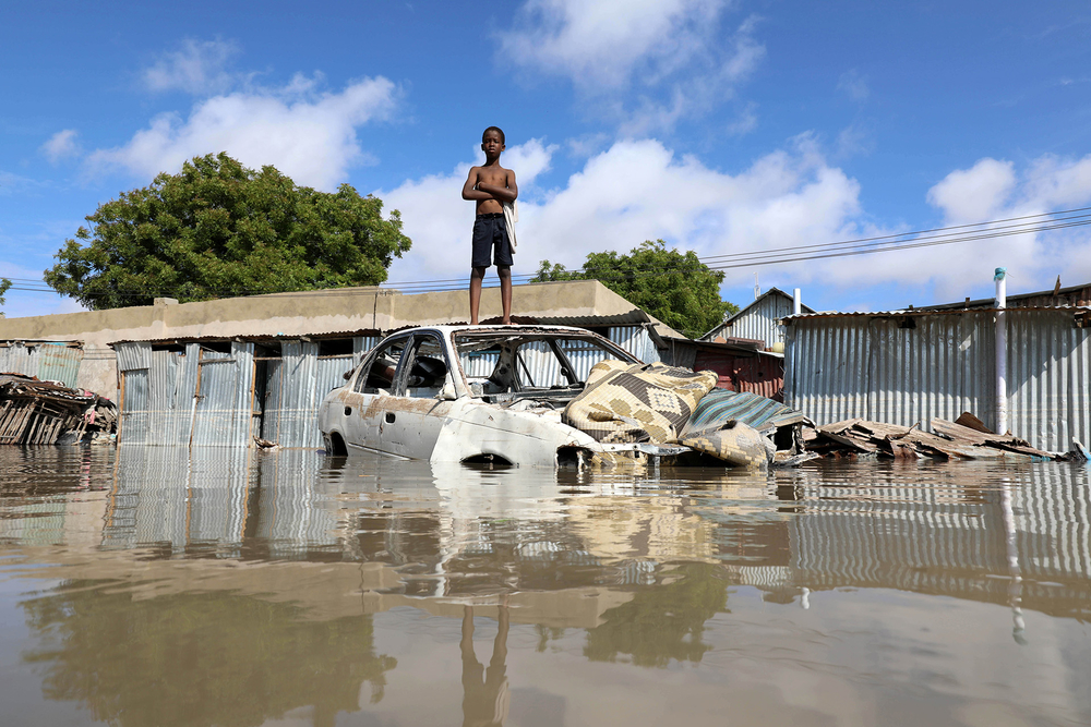 A Somali boy stands on a junk vehicle after heavy rain flooded their neighbourhood in Mogadishu, Somalia 21 October 2019.