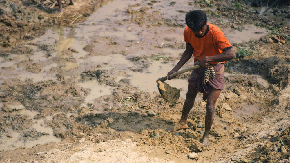 A Rohingya man helps to dig a drainage system in Bangladesh's Kutupalong refugee camp.