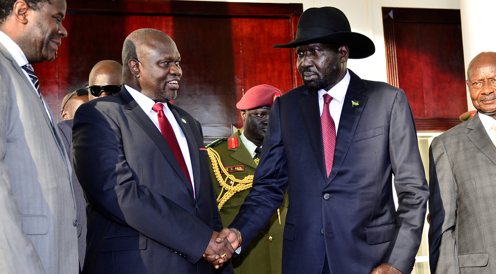 Leader of the Sudan People's Liberation Movement In Opposition (SPLM-IO) Riek Machar shakes hands with South Sudan's President Salva Kiir in Entebbe, Uganda, 7 November 2019.