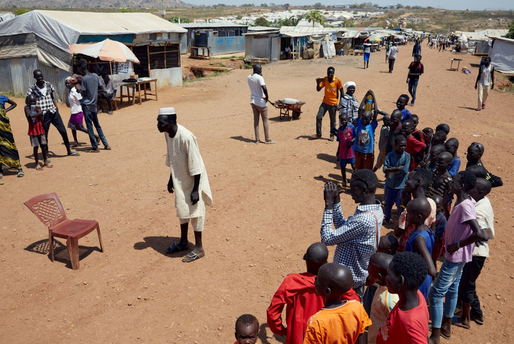 Street performers entertain the crowd at a displacement camp in South Sudan's capital.