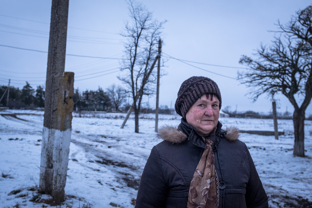 Vera, a resident of the village of Nykyforivka, must singlehandedly rebuild her house that was destroyed by the bombs of separatist forces.