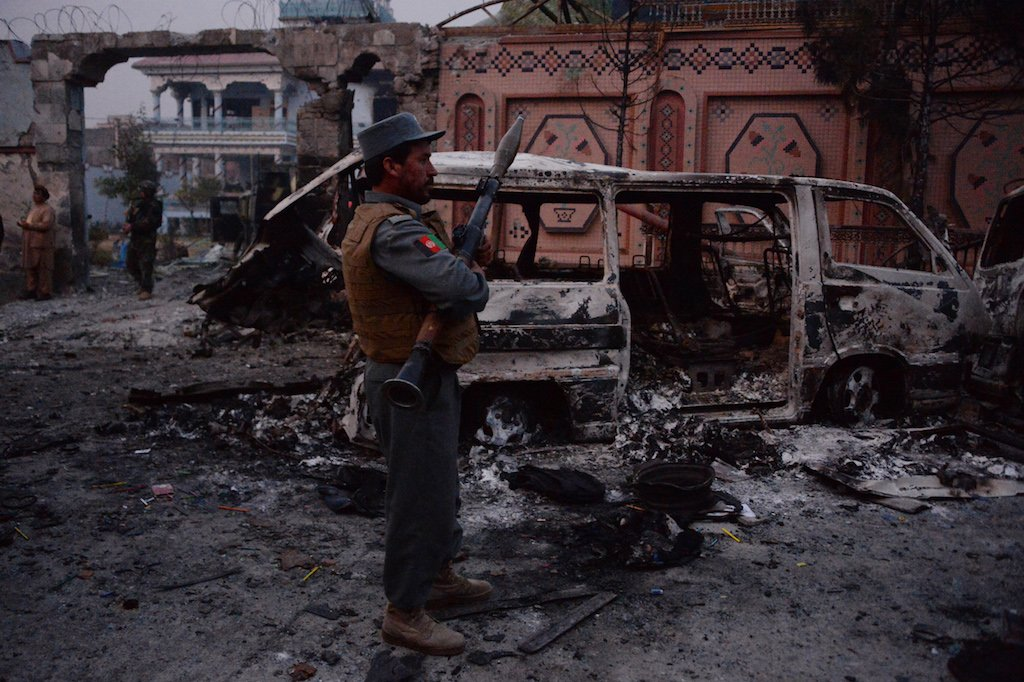 Afghan security forces inspect the site of an attack on the offices of the NGO Save the Children in Jalalabad on 24 January, 2018.