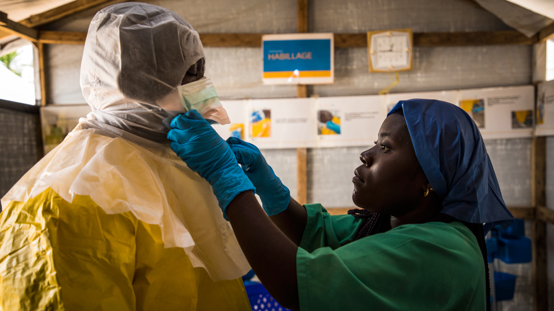 A health worker puts on protective scrubs before entering an Ebola treatment centre in Beni, Democratic Republic of Congo.