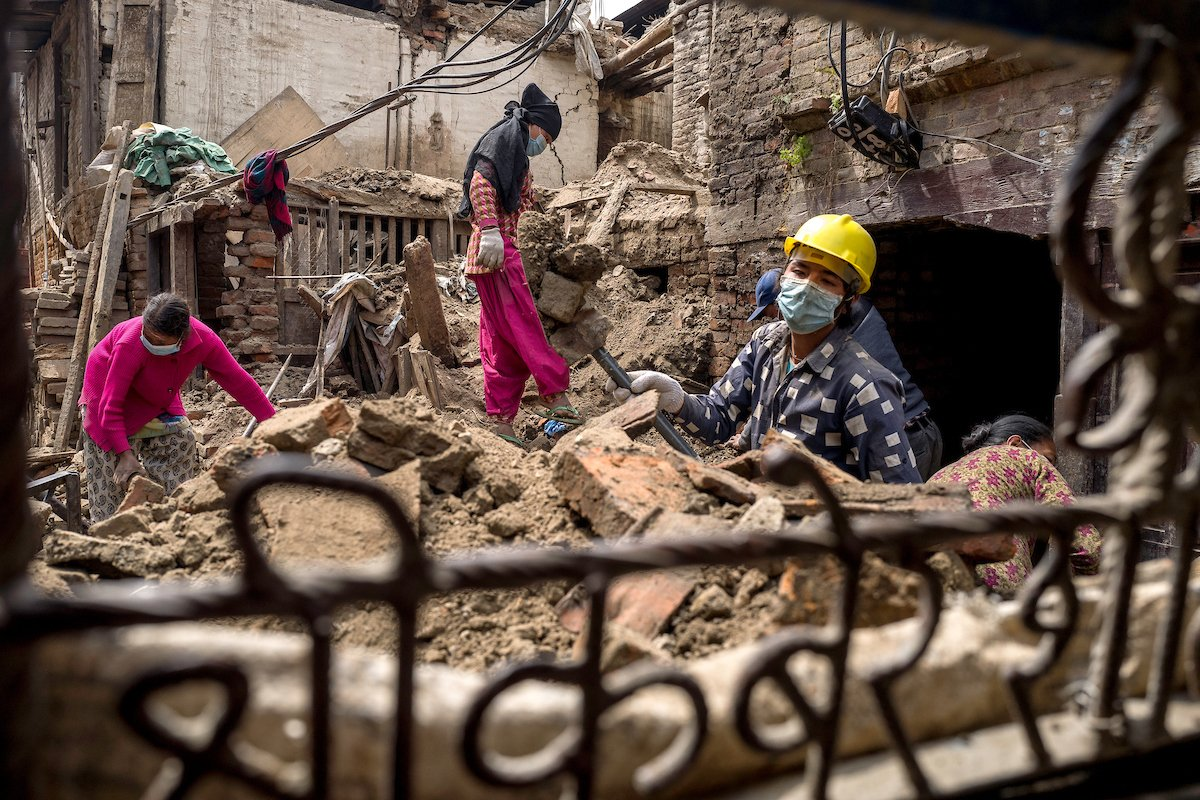 Labourers clear debris from a collapsed home in Bhaktapur, Nepal.