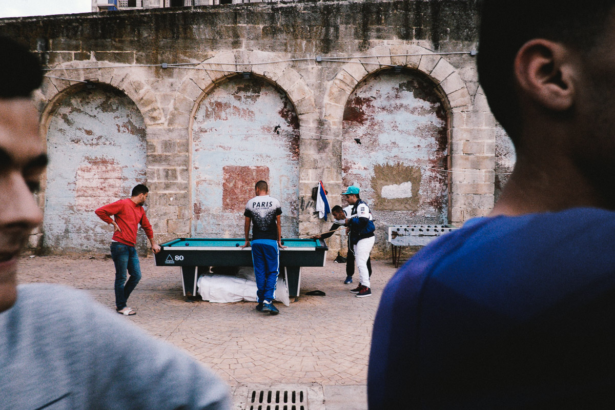 Young men play pool