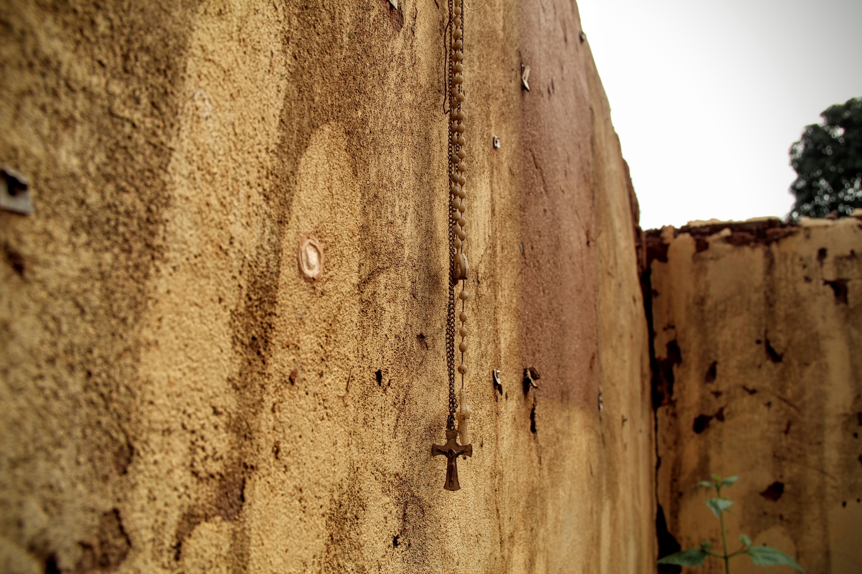 A crucifix hangs on a wall