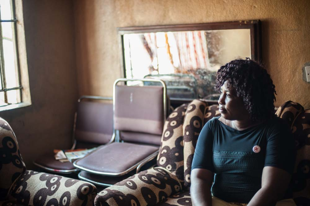 Kargbo, an ebola burial worker, sits in her lounge in Wellington, Sierra Leone