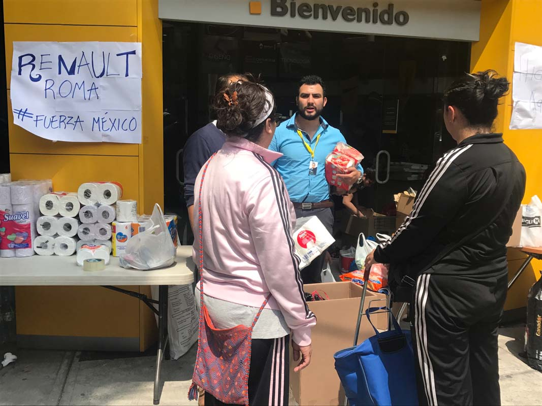 Volunteers at a car dealership in Mexico City helping after the earthquake.