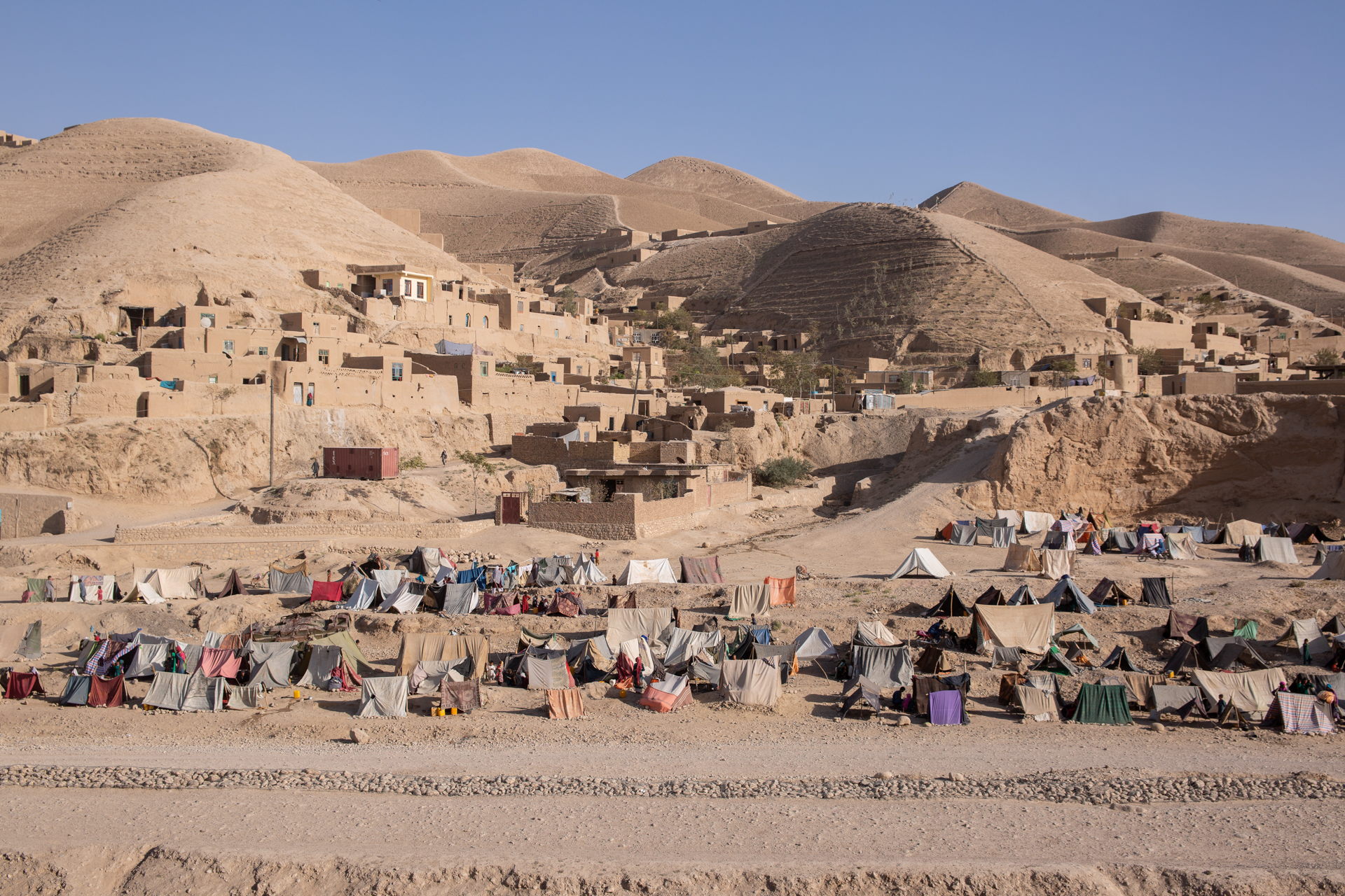 A landscape of tents on a sandy mountain