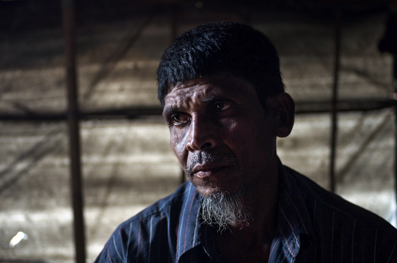 A Rohingya man looks away from the camera