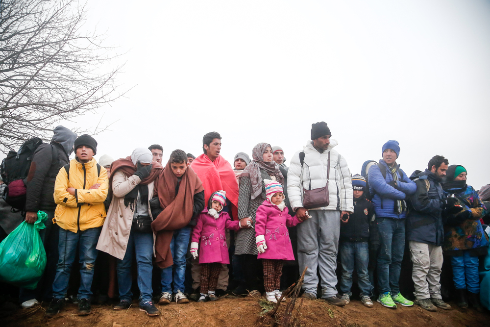 Asylum seekers attempting to cross into Macedonia