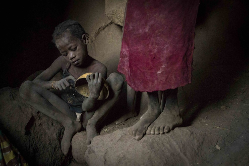 Children hide in cave Sudan