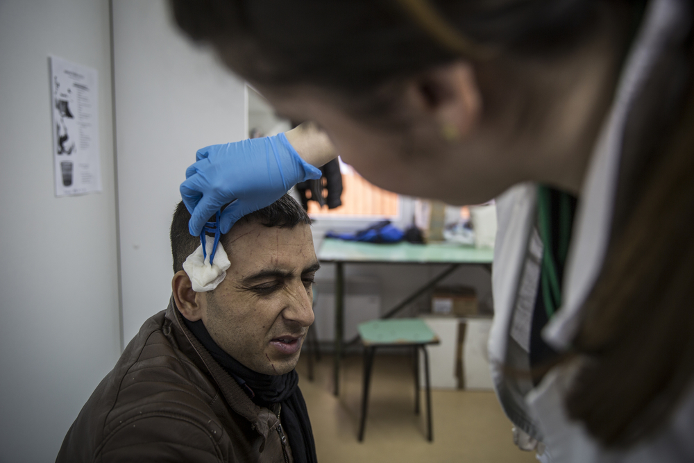 Javed Zamankhil, 24, from Kunduz, Afghanistan, has scratches treated by the WAHA medical team