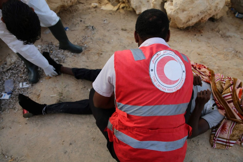 Libyan Red Crescent volunteers find another migrant body on Garibouli beach, near Tripoli, which has become increasingly used by people smugglers to launch boats