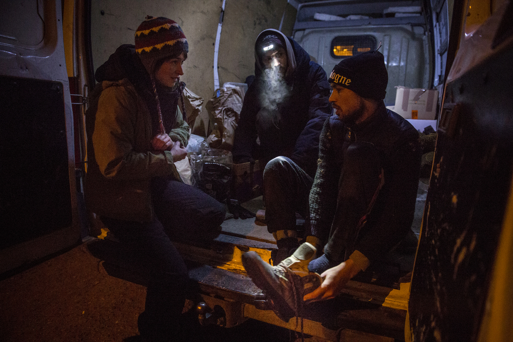 German volunteers from the organisation I'm Human provide Shafiullah Muzaffar with dry boots, socks, gloves and a hat