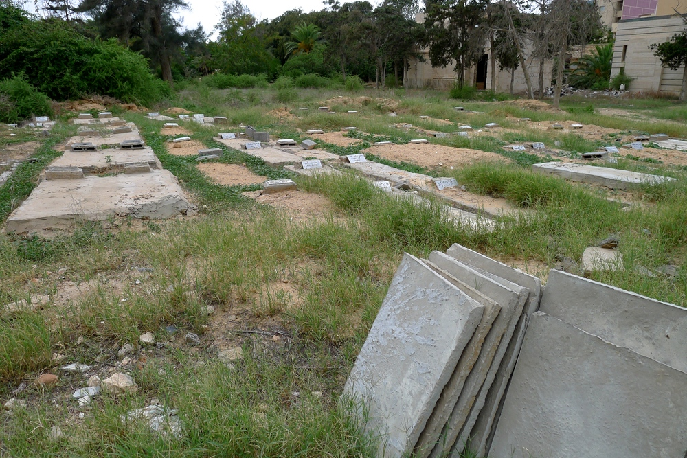 Migrant graves in the Tripoli Christian cemetery. All have a headstone bearing the date of burial and reference number so they can be traced back to the DNA database