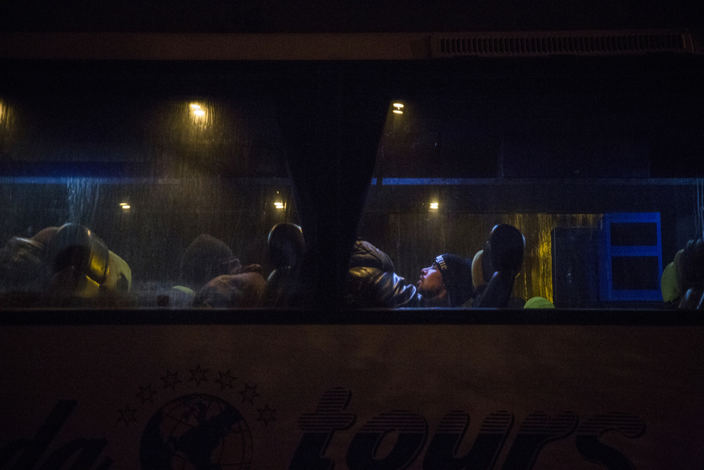 Afghan migrants wait for the bus to depart for Belgrade