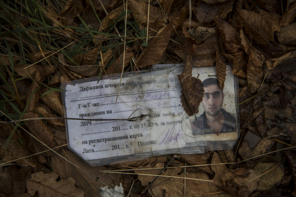 A Bulgarian identification document discarded on one of the paths through the forest that migrants use to cross into Serbia on their way to Western Europe