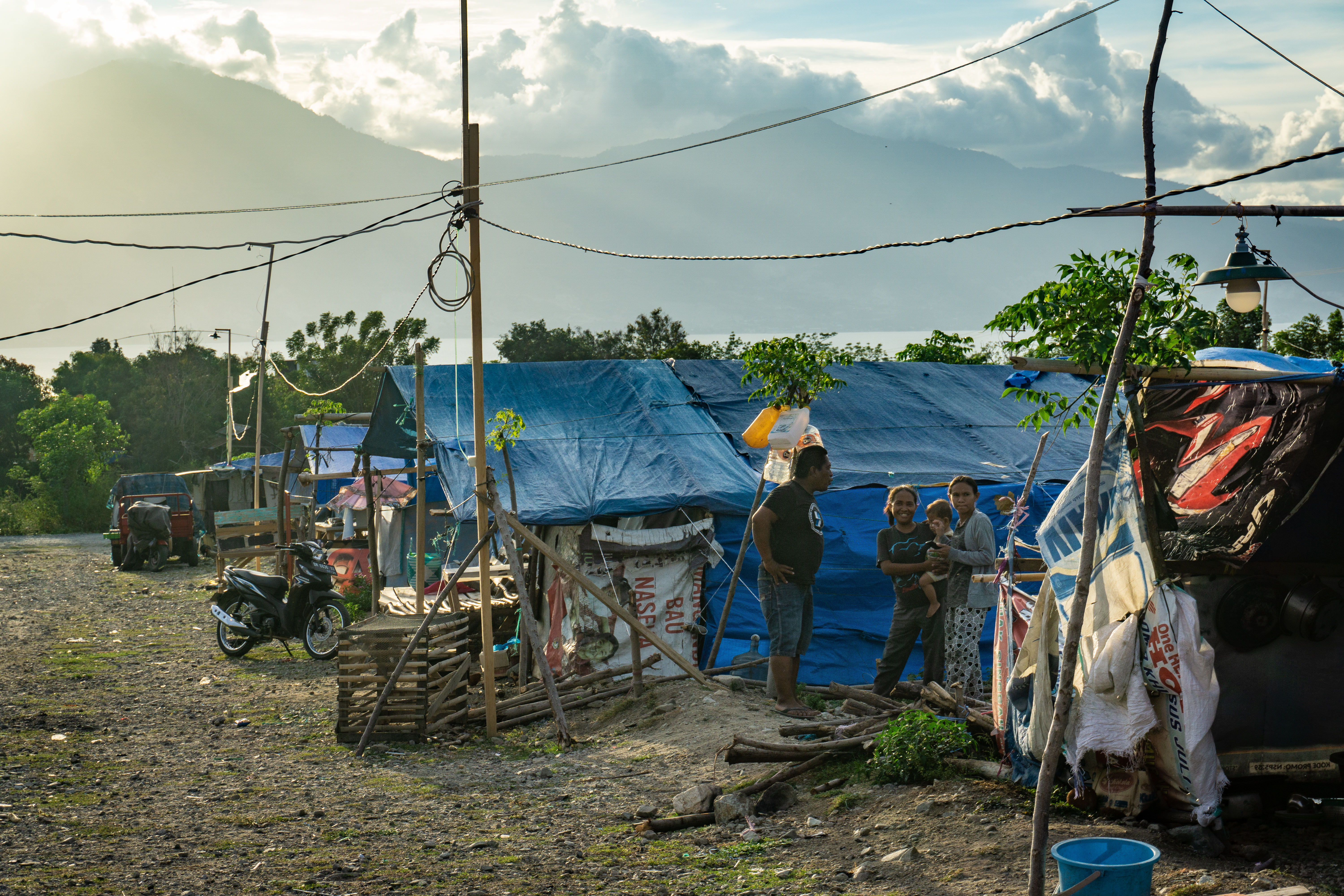 A family in a tent camp on the outskirts of Palu.