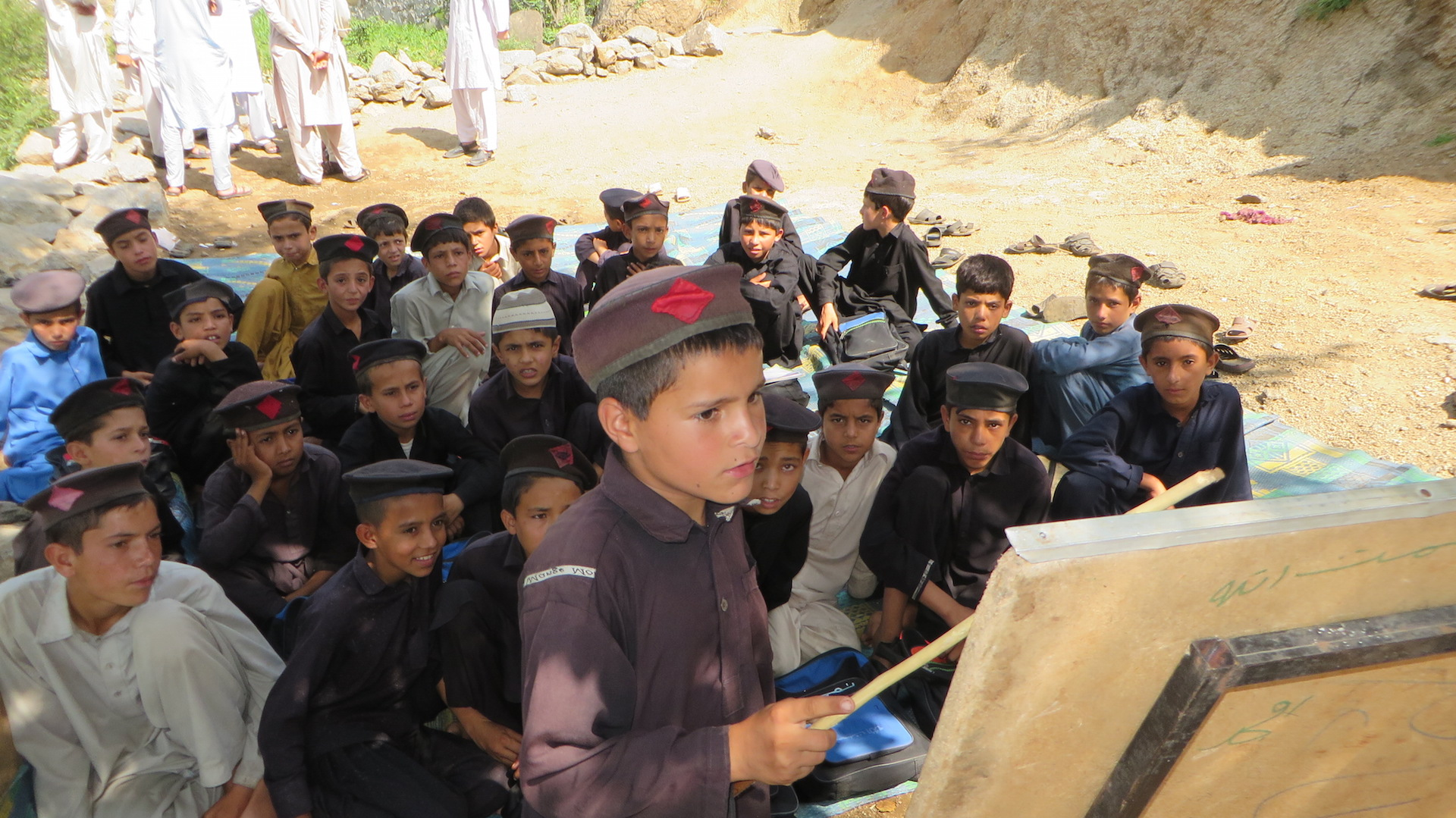 Children studying in an open air school in the town of Mamund