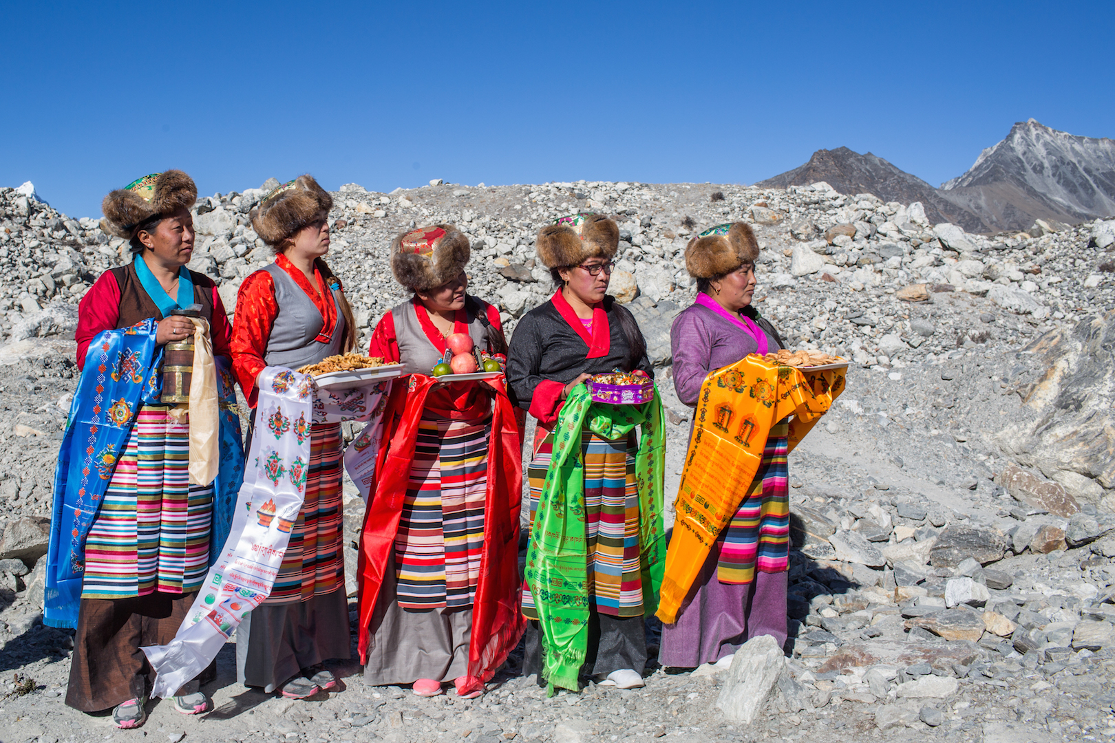 Sherpa women in traditional attire take part in a ceremony to celebrate the completion of a project to lower the water level in Imja Lake