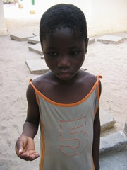 [Togo] Enyonam, who has just arrived at a centre for trafficked children in the Togolese capital, Lome, shows her scarred fingertips. He master accused her of stealing eggs and burnt the ends of her fingers with a match as punishment. February 2005.