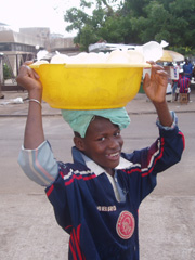 [Guinea] Boy selling water on the street in Conakry. [Date picture taken: 06/01/2006]