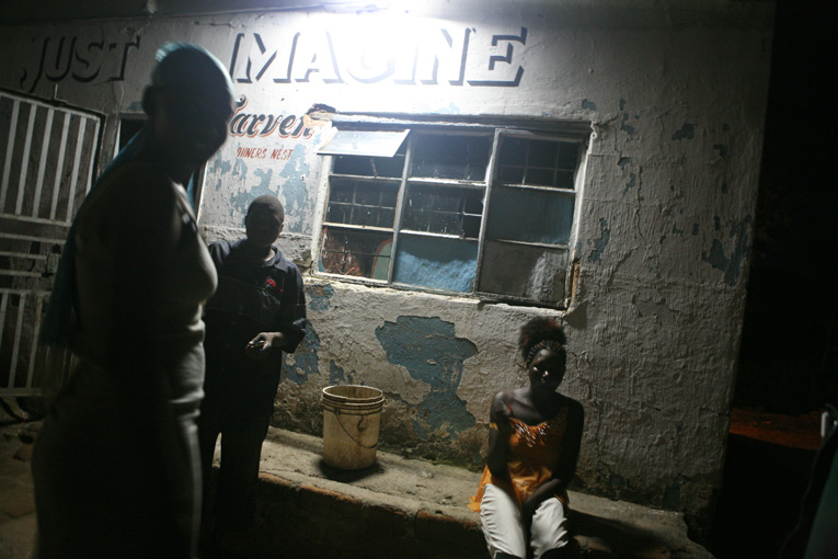 Young sex workers stand outside a bar, March 2007. Alcohol and drug use can lower inhibitions, increasing the risk of HIV infection. However, some groups are especially vulnerable - most notably young women. The impact of HIV/AIDS has gone far beyond the