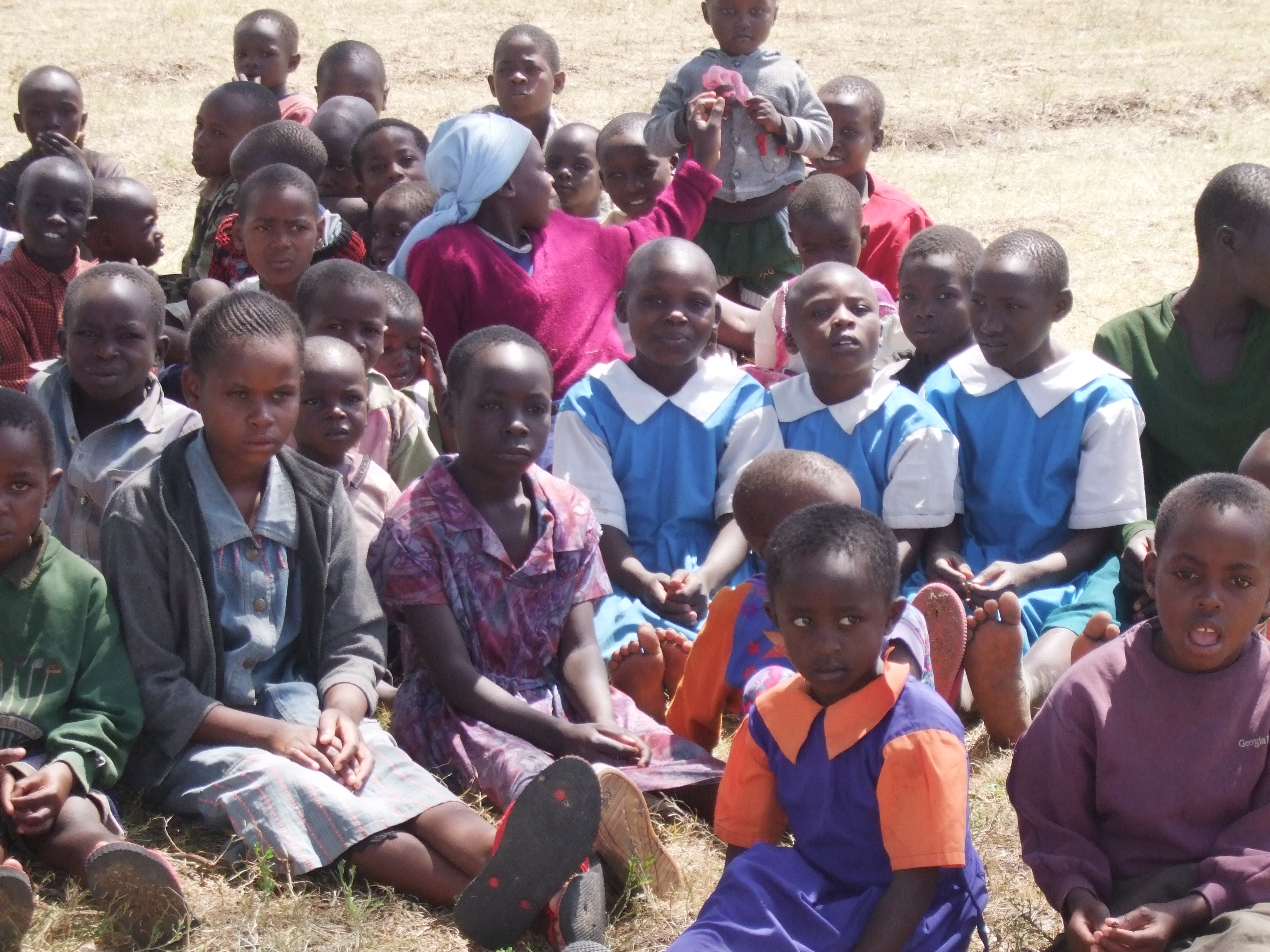 School children attend class under a tree in Mulot IDP Camp in South Narok District.