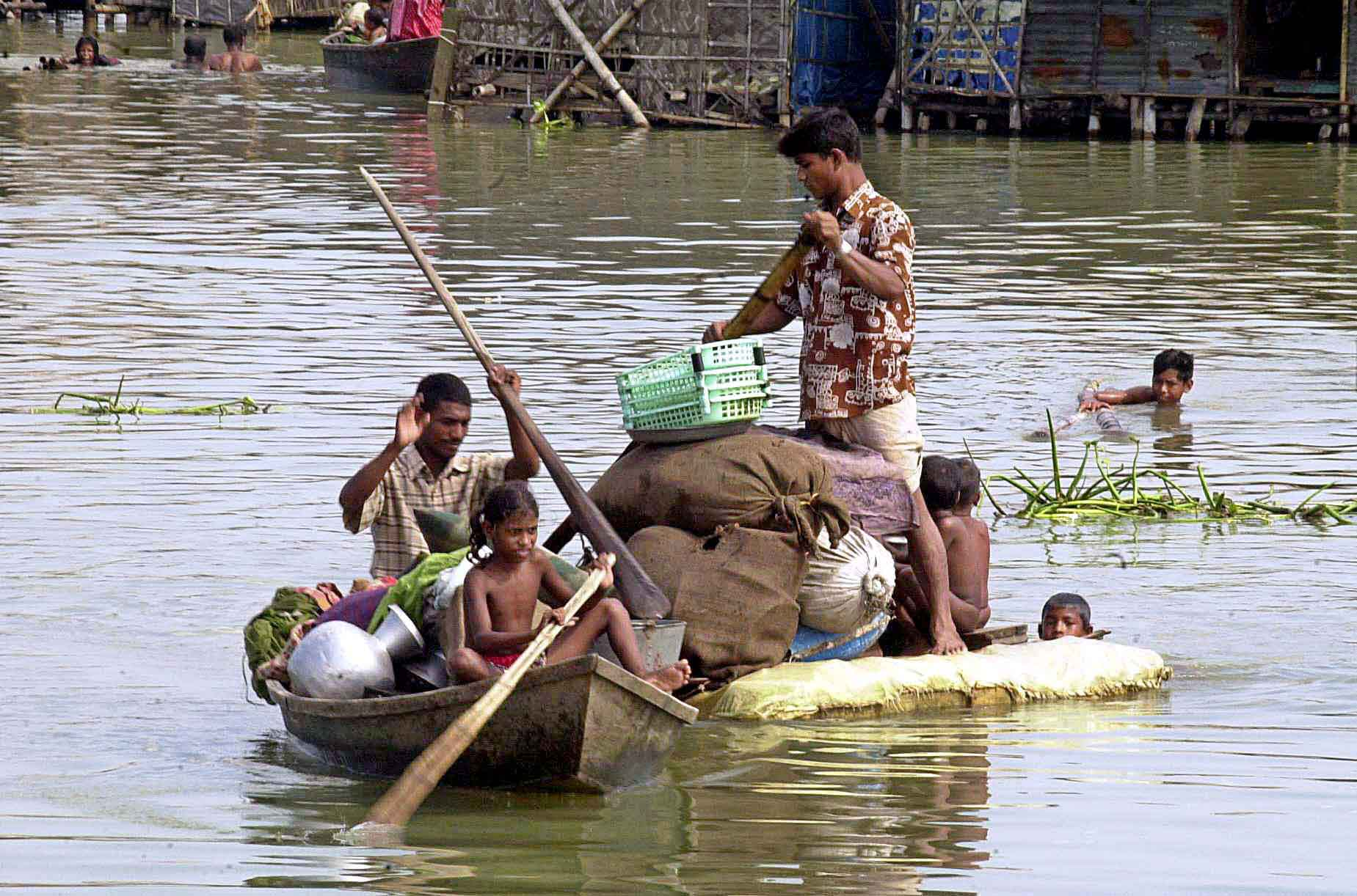 Shifting to a flood-free area by raft in Rangpur, north-western Bangladesh.