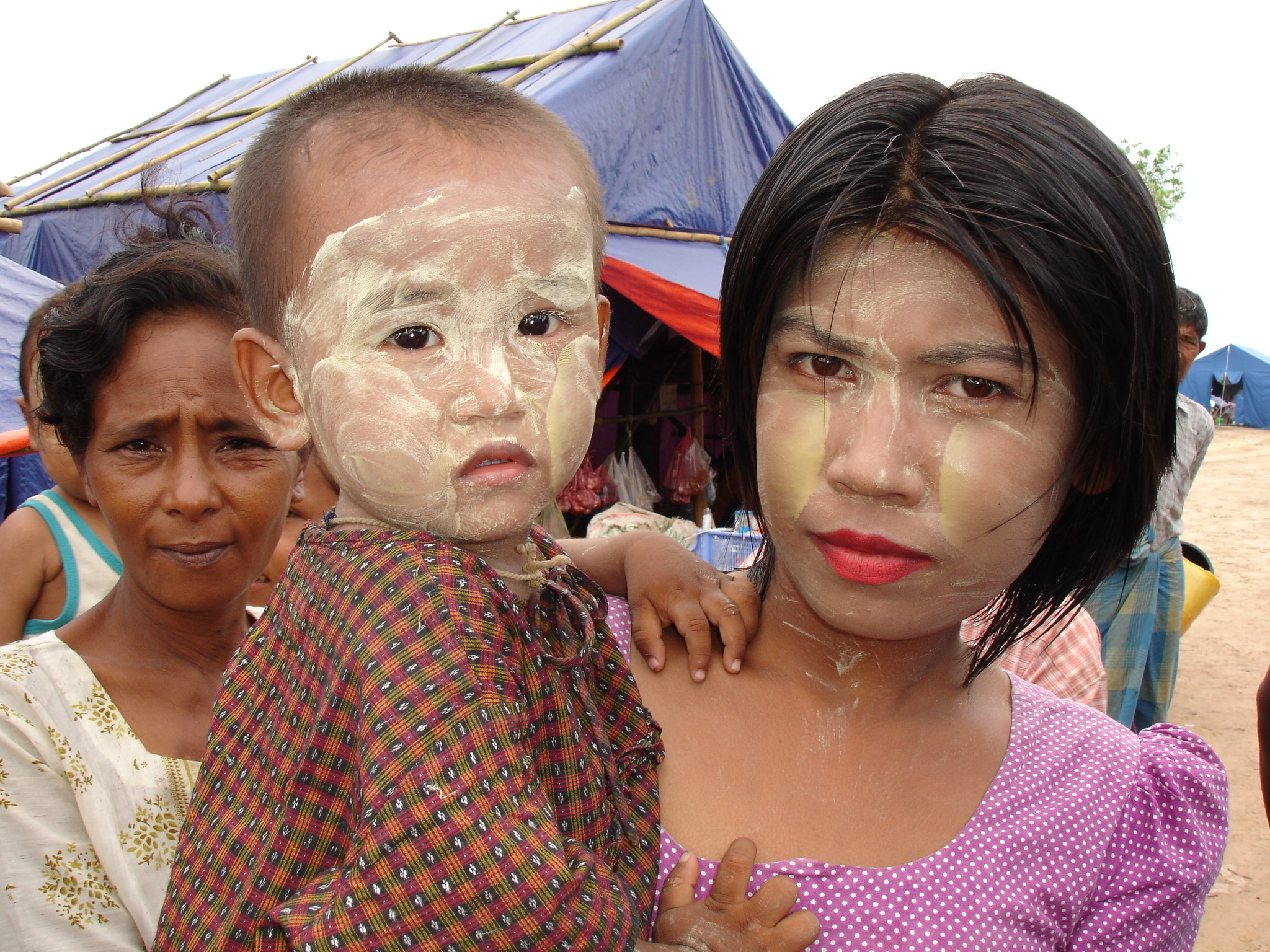 A young mother and her child at a displaced persons camp on the outskirts of Labutta, southern Myanmar. Thousands of people were displaced by Cyclone Nargis when it slammed into the Ayerwadyy delta in May 2008, leaving more than 138,000 dead or missing.