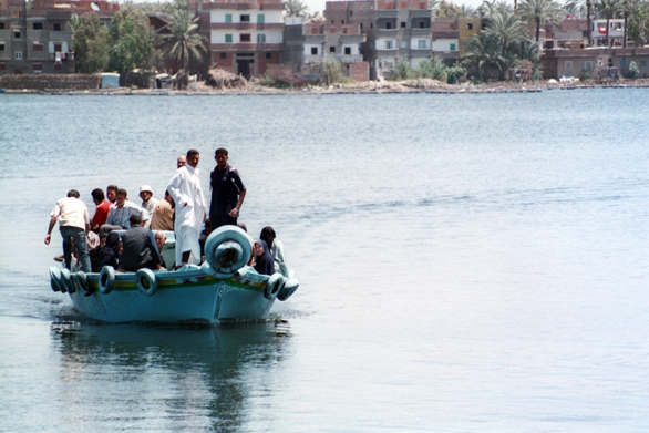 A ferry crossing from one side of the Nile to the other in the coastal city of Rashid, where migrants continue their journey into the Mediterranean Sea.