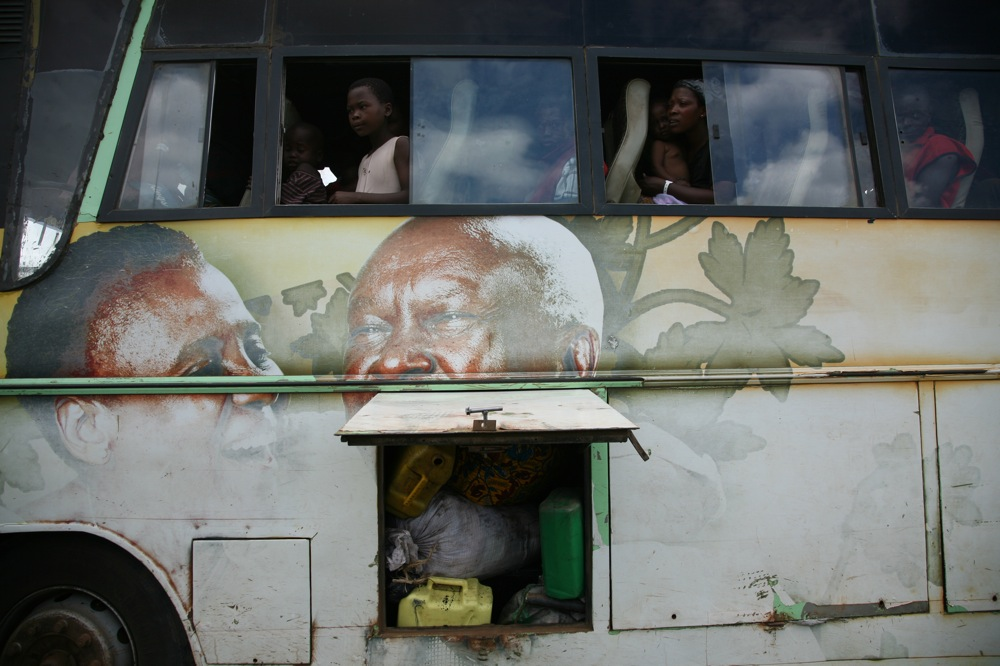Hundreds of refugees from Democratic Republic of Congo board buses in the Uganda/DRC border town of Ishasha to be transported to a permanent refugee settlement camp in western Uganda. November 2009