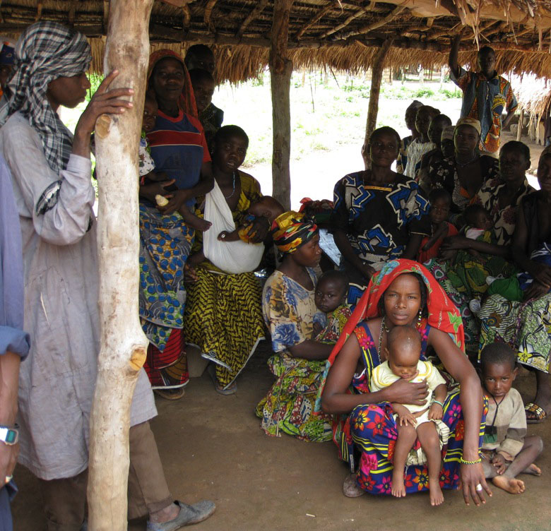 Patients wait outside a clinic in Farasala, a village near the town of Kabo in Central African Republic