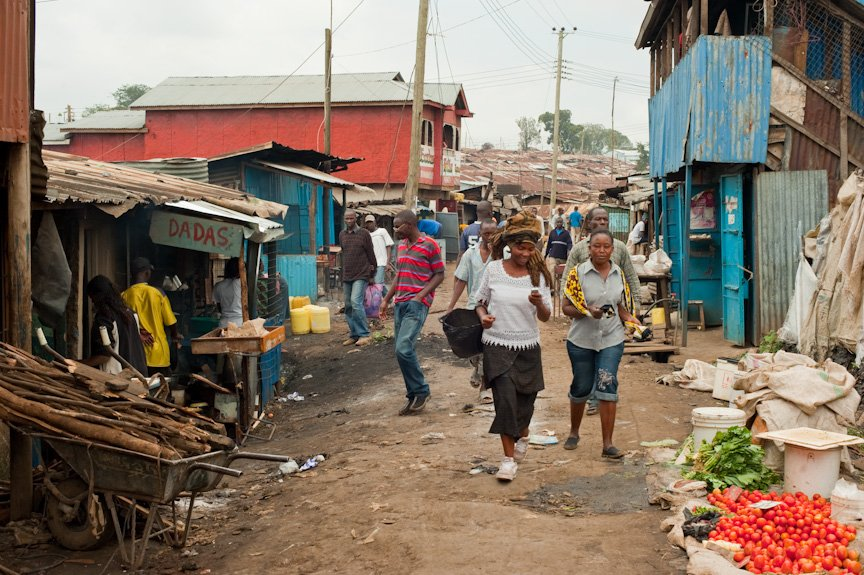 A street scene from Kibera, reputed to be Africa's largest slum. According to UN-HABITAT, millions of Kenyans living in slums are among those worst hit by high food prices yet they receive far less humanitarian attention than other demographic groups