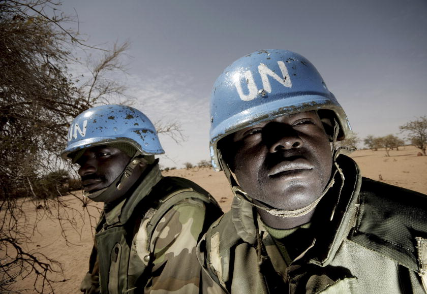 Members of the Nigerian battalion of the United Nations-African Union Hybrid Mission in Darfur (UNAMID) on patrol during a community meeting between UNAMID officials and Arab nomads