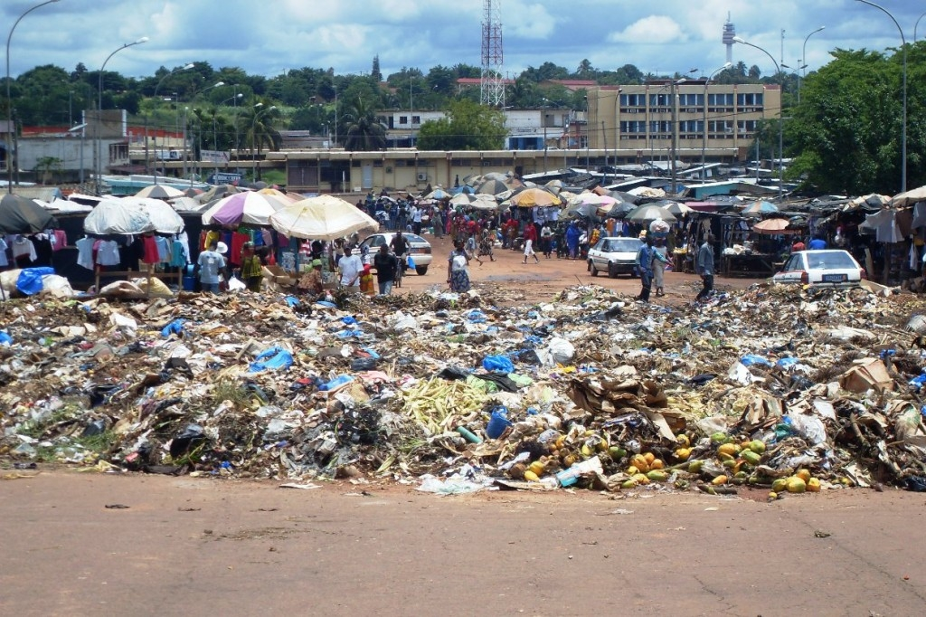 Rubbish piles next to a marketplace in Adjamé District of the economic capital Abidjan