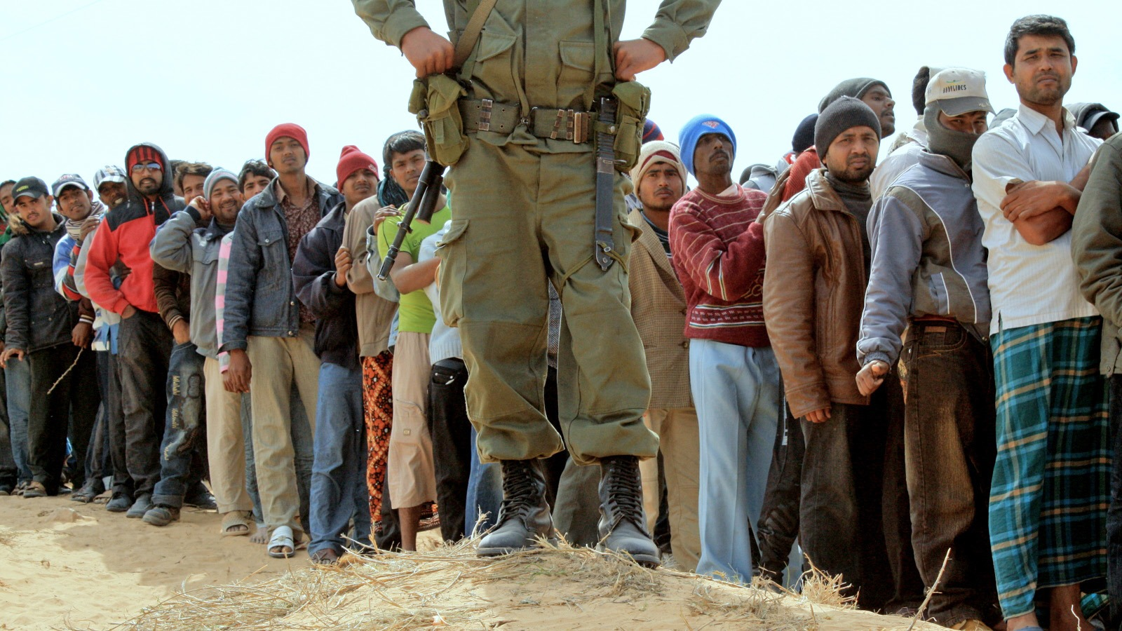 People line up for food at Choucha camp, at the Libya-Tunisia border
