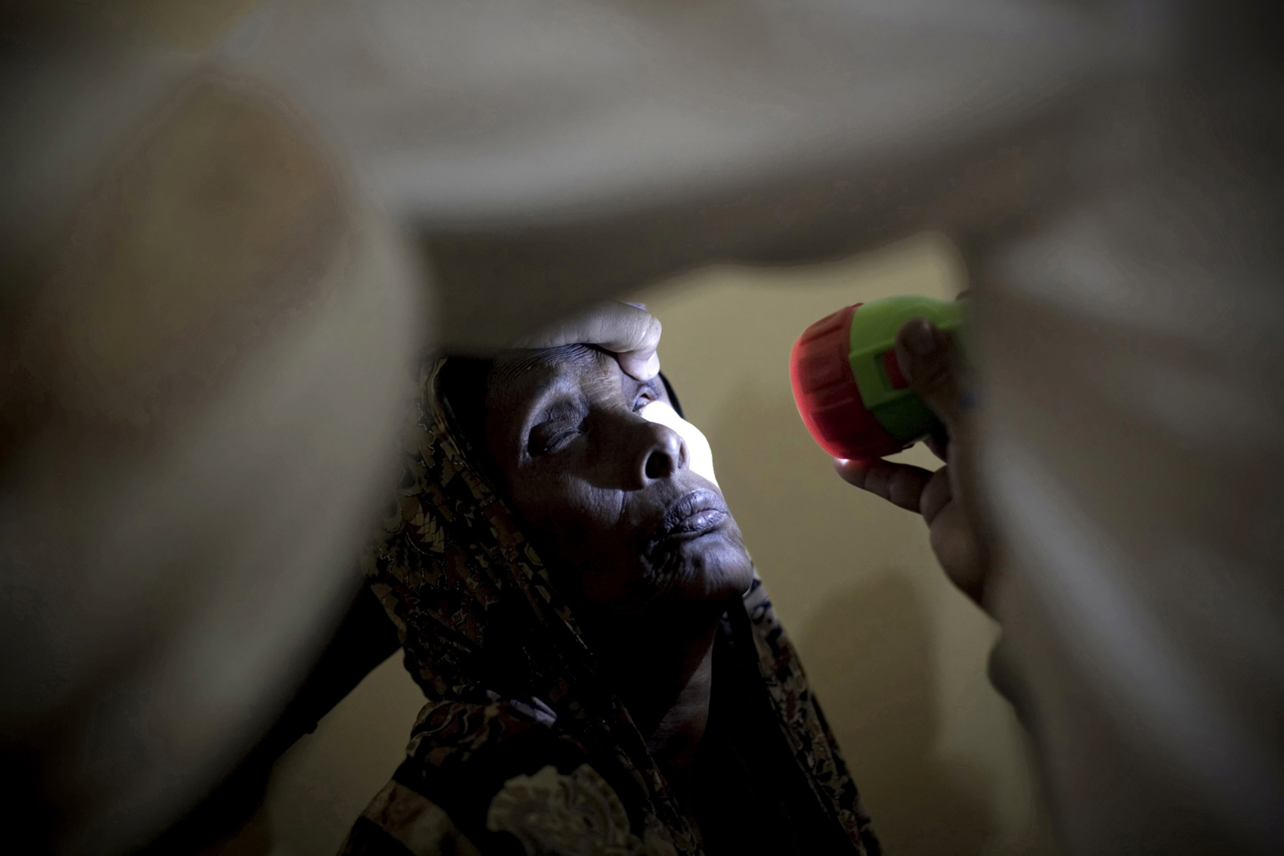 A woman gets her eyes checked at the MSF Holland hospital in Galcayo South in Puntland, Somalia on March 20, 2011 during an eye surgery camp aimed at giving hundreds of Somali's back their sight. This is the third eye surgery camp supported by MSF in the